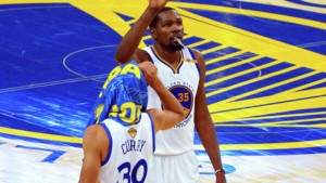 Jun 12, 2017; Oakland, CA, USA; Golden State Warriors forward Kevin Durant (35) celebrates with Golden State Warriors guard Stephen Curry (30) during the fourth quarter in game five of the 2017 NBA Finals at Oracle Arena. Mandatory Credit: Kelley L Cox-USA TODAY Sports