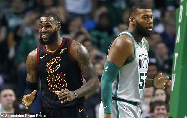 Cleveland Cavaliers' LeBron James (23) reacts to a call beside Boston Celtics' Greg Monroe (55) during the second quarter of an NBA basketball game in Boston, Sunday, Feb. 11, 2018. (AP Photo/Michael Dwyer)